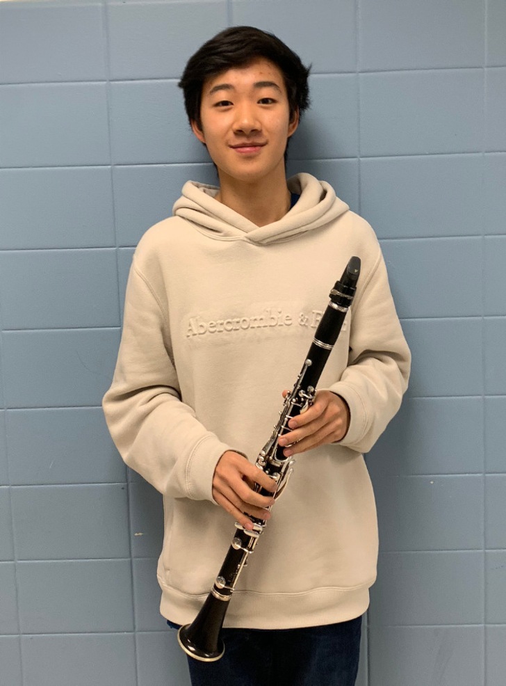 Scotch Plains-Fanwood HS senior Jonathan Yu with his clarinet.png