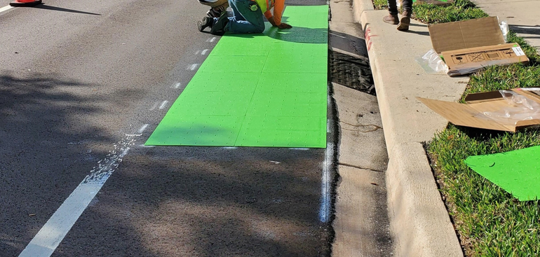 Green-colored bike lane surfacing installed at Turtle Creek Drive and NW 62nd Avenue.