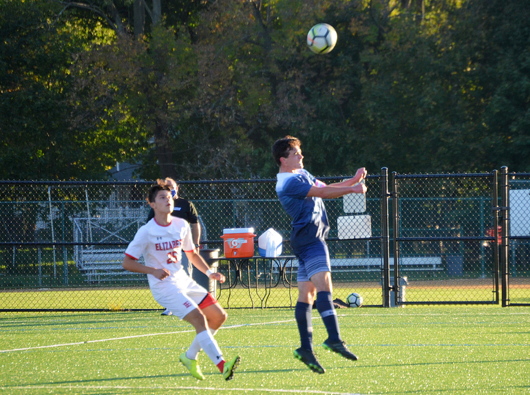 Scotch Plains-Fanwood player heads the ball.png