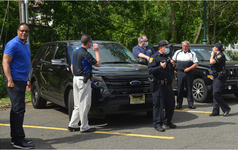 Scotch Plains Police await the arrival of Fanwood Lt. Frank Marrero.png