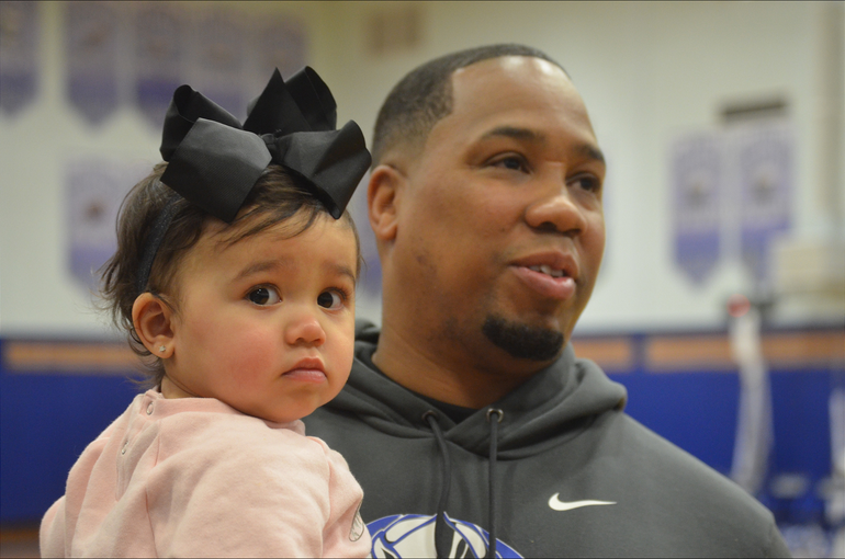 Scotch Plains-Fanwood football coach Austin Holman and his daughter, Kennedy, watched the basketball team win on Satuday..png