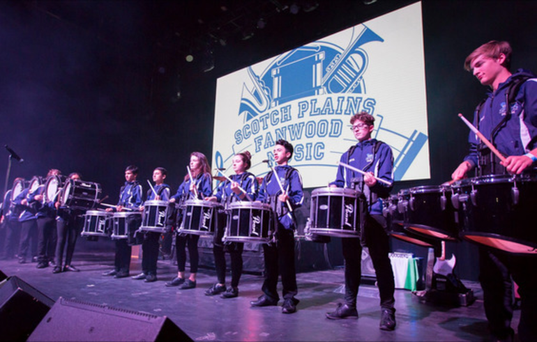 Scotch Plains-Fanwood Marching Band drummers preformed on stage with U2 tribute band Unforgettable Fire.