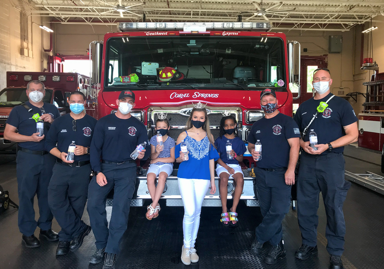 Alana Scheuerer, center, with staff from Coral Springs-Parkland Fire Department.