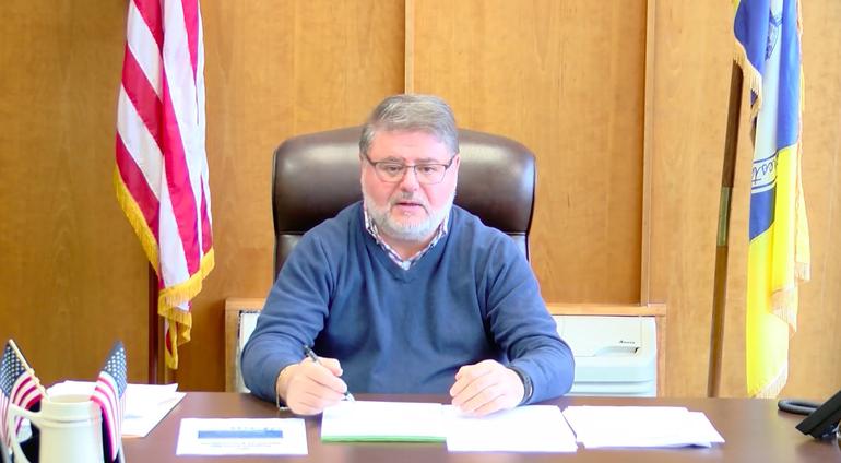 Mayor Chris Vergano At His Desk.png