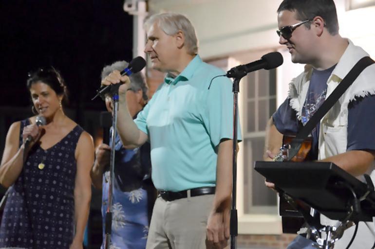 Scotch Plains Deputy Township Manager Margaret Heisey, Mayor Al Smith, and Redevelopment Coordinator Tom Strowe sing karaoke.