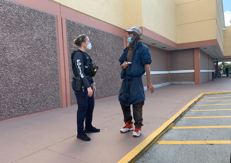 Coral Springs Police Officer Marla Ferry talks to Joe who is homeless.
