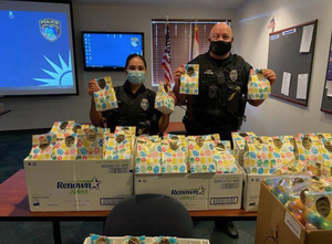 Coral Springs Police Office Monica Ardila, on the left, and Officer Russ Henning preparing the goodie bags.