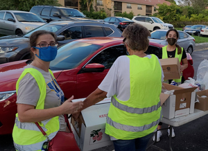 Volunteers loading off into cars at a food distribution at Chabad of Coral Springs.