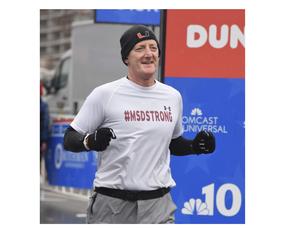 Doug Eaton running in a marathon in Philadelphia in 2020.