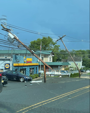 JCP&L utility poles down on Watchung Avenue in Chatham