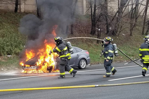 Union firefighters battle car fire