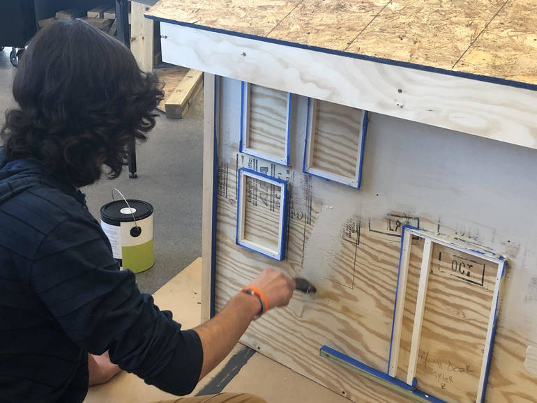SDF student working on house.jpg