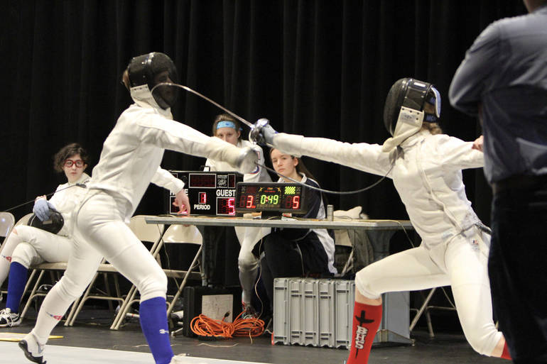Senior epee Emily Berkow  (left, blue sock) in a blade-bending bout on Super Saturday.jpeg