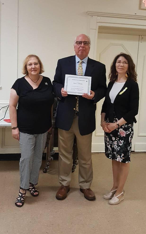President Jane Rundella (left) and VP Alberta Esposito present speaker Steven Wheatley with the Club's Certificate of Appreciation for his presentation on flags.
