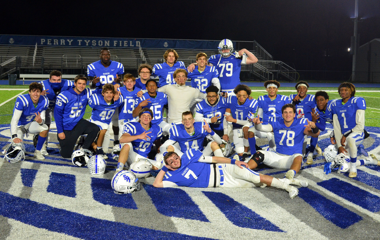Scotch Plains-Fanwood seniors celebrate victory over Colonia in their final game.