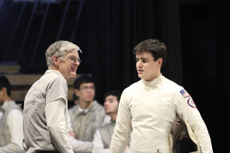 Senior epee John Walsh advised by Assistant Coach Satchell before winning a bout on Super Saturday.jpg