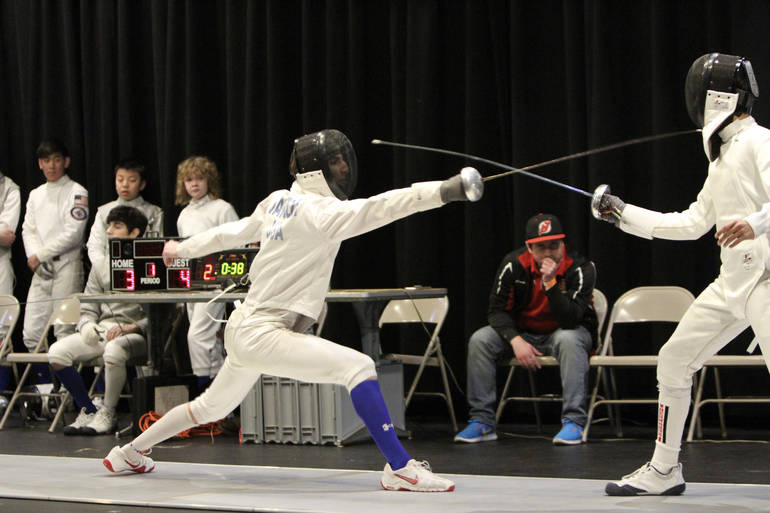 Senior epee Blake Januzzi (left, blue sock) lunges to a win on Super Saturday.jpg