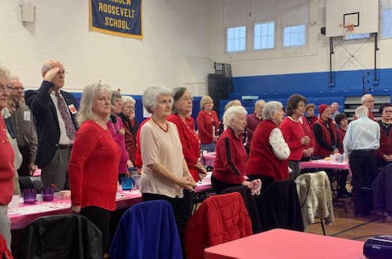Seniors stand for the Star Spangled Banner.jpeg