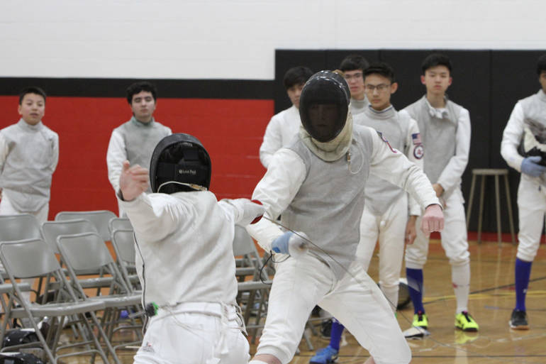 Senior foil Lucas Piccininni during one of his three wins at West Essex.jpg