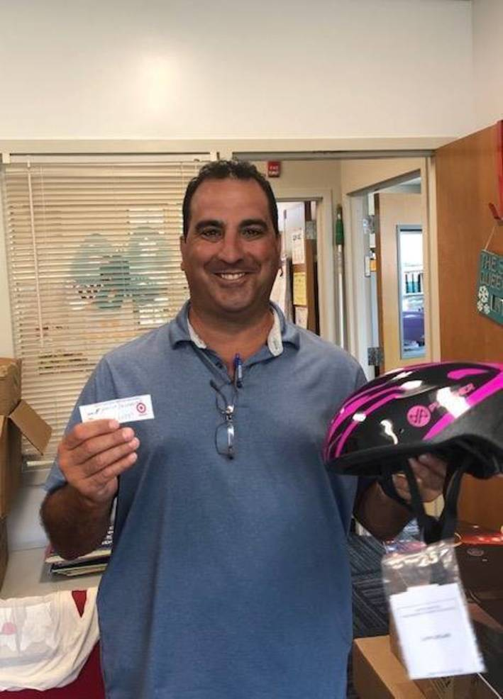 SGT Cassio pulling raffle winners from NNO at SP Library.jpg
