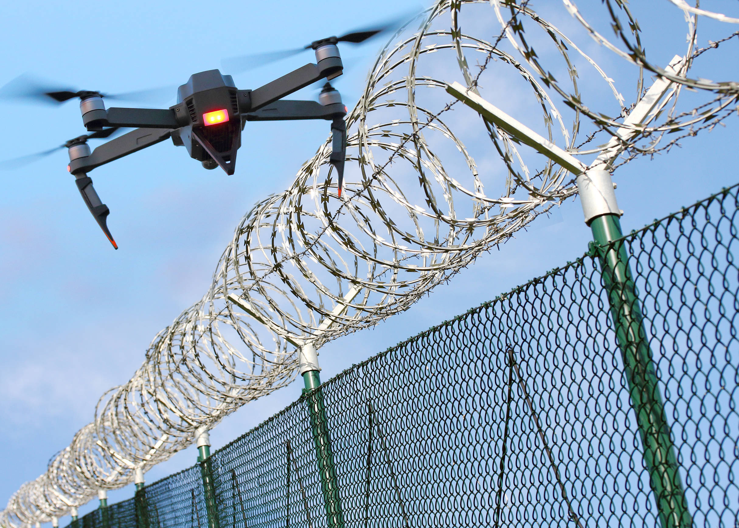 shutterstock_790134829 Prison fence with drone.jpg