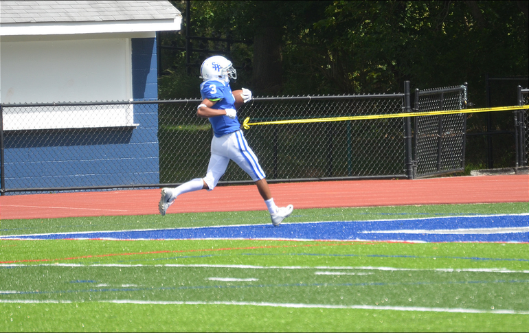 Scotch Plains-Fanwood running back Shawn Martin scores the first of two touchdowns in the Raider's season opener on Saturday, Sept. 7.