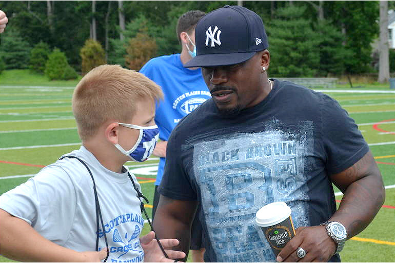 Scotch Plains-Fanwood PAL president Shawn Johnson and camper.png