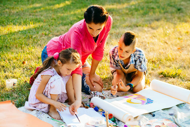 shutterstock_714298681 two kids and mom in park.jpg