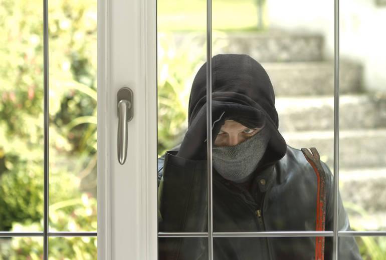 Lower Merion burglar peering into rear door about to break in.jpg