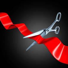 Carousel image 5c8d63cdd7e985e676e6 shutterstock 73914535 red ribbon cutting