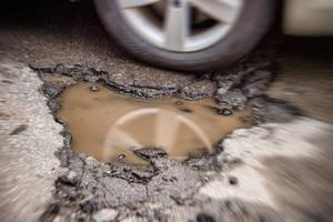 Carousel_image_7e75c25243f7d50859ed_shutterstock_626253995_pothole