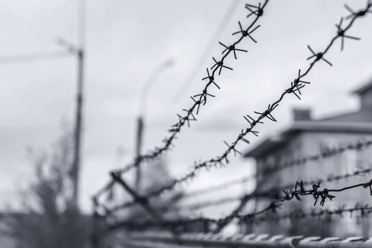 Top story 1fc0e7303a7adcd66f66 shutterstock 1054179410 barbed wire at prison
