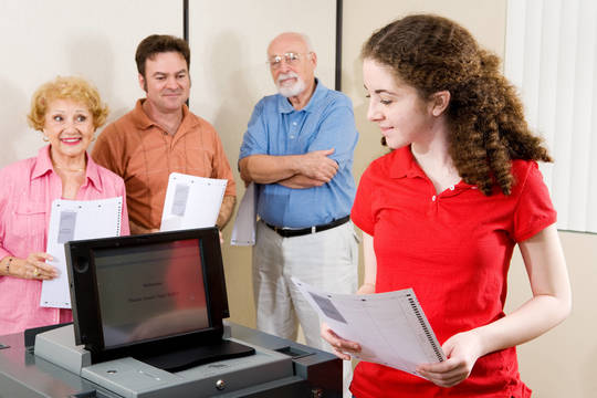 Top story 50d1cd160e0727d879fb shutterstock voting scanners with paper ballot