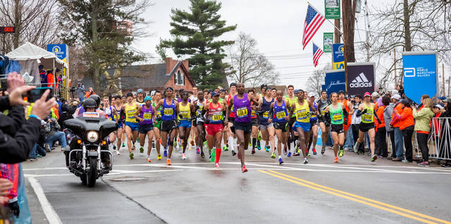 Top story c85395de386765bc81d8 shutterstock 291331064 boston marathon runners
