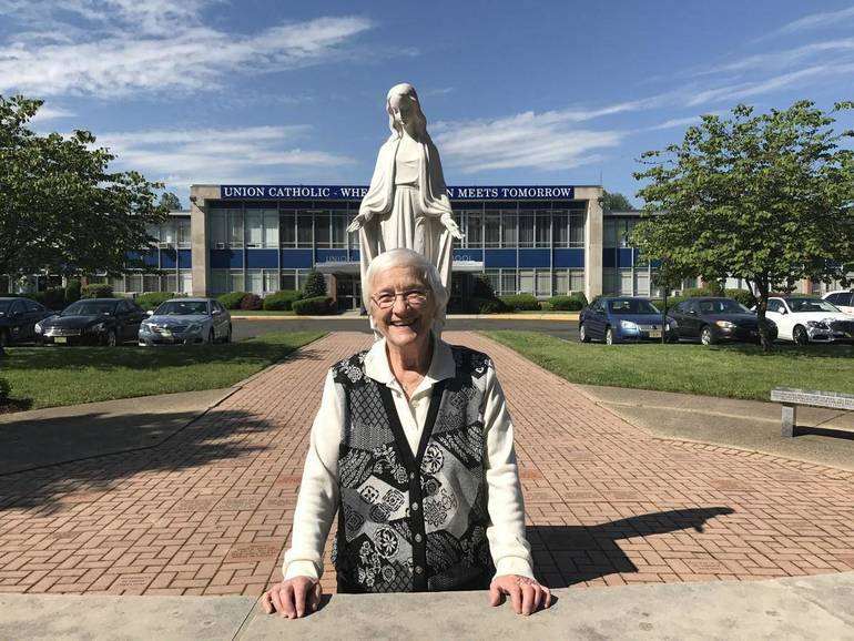Sister Percylee in front of school.jpg