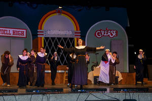 Carousel image 46bf2cca3cb61ecac3d0 sister mary hubert  played by anna souls  leads a musical number