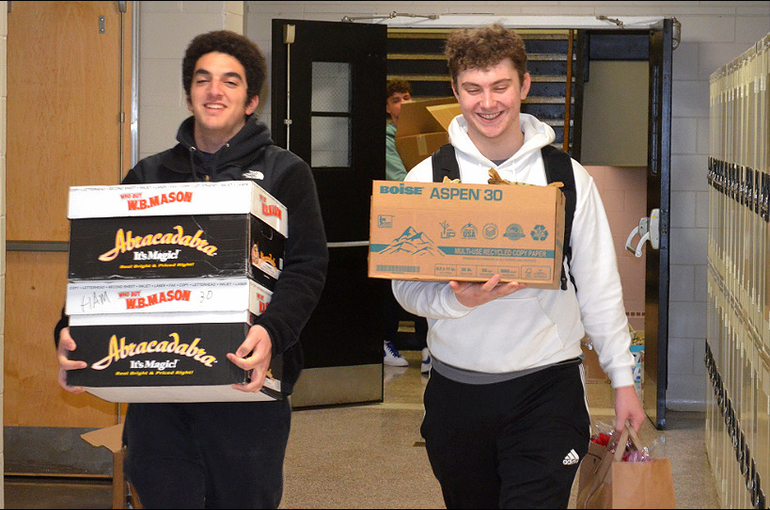 SJS - Saint Joseph students help deliver sandwiches for the homeless.png