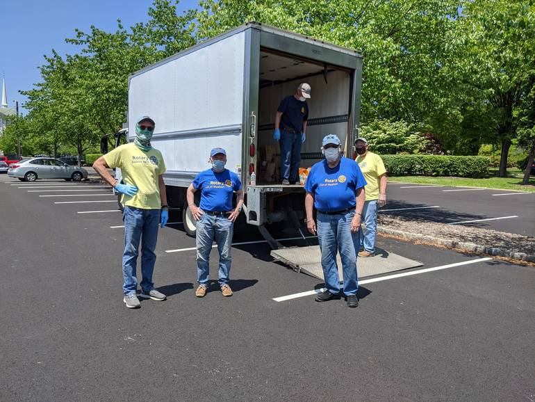 Smaller group Rotarians behind truck.jpg