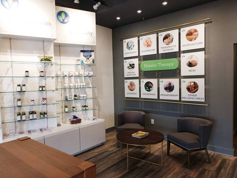 Retail interior featuring brand wall and store product shelves