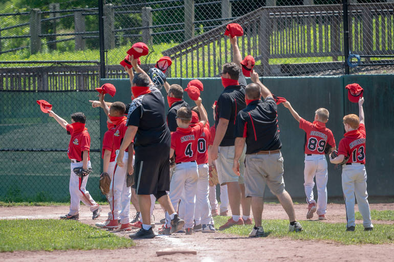 Somers celebrates their victory and tips their caps to John Jay-Lewisboro.JPG