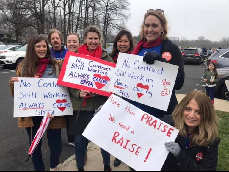 Teachers picketed outside the Scotch Plains-Fanwood Board of Education building on Tuesday, April 9