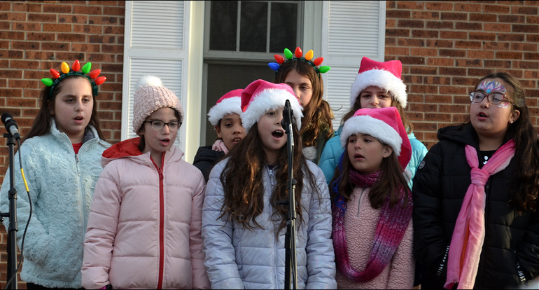 SPX10 - Group singing Holiday music in Scotch Plains.png