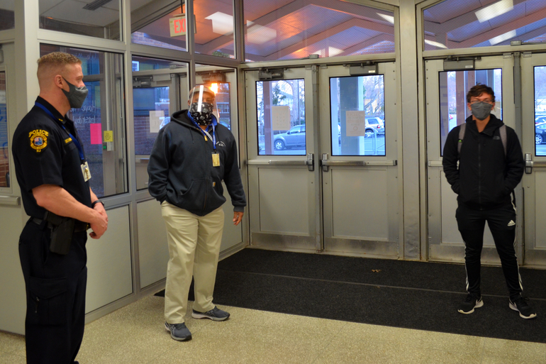 SRO Detective Hernandez and Coach Rich McGriff greet students at Scotch Plains-Fanwood High School.