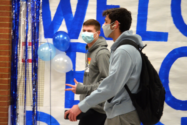 Student walking the halls in between classes at Scotch Plains-Fanwood High School.