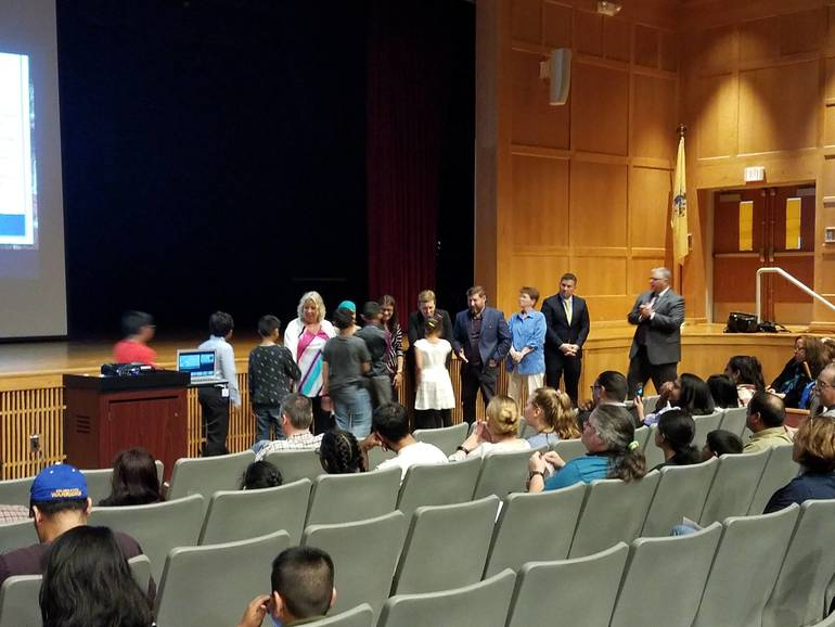 Students Greet the BOE and Central Administrators Before Receiving Their Certificates..jpg