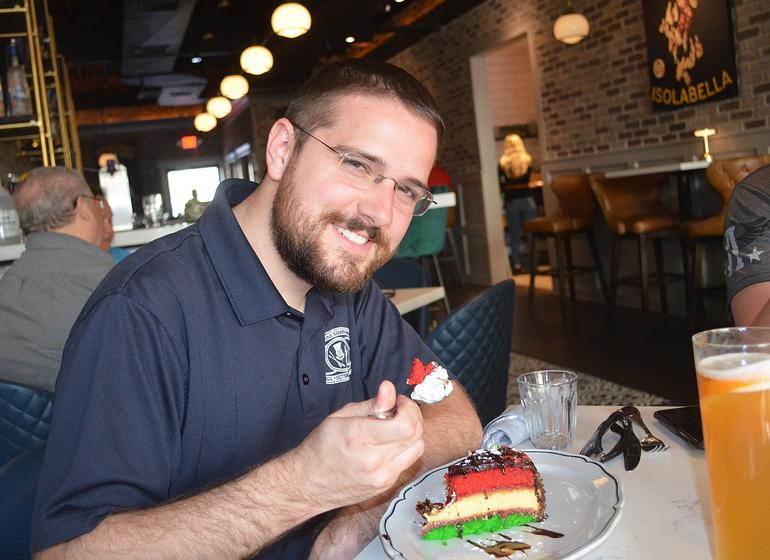 Tom Strowe enjoys the rainbow cake at Grano Pizzeria & Italian Tavern in Scotch Plains.