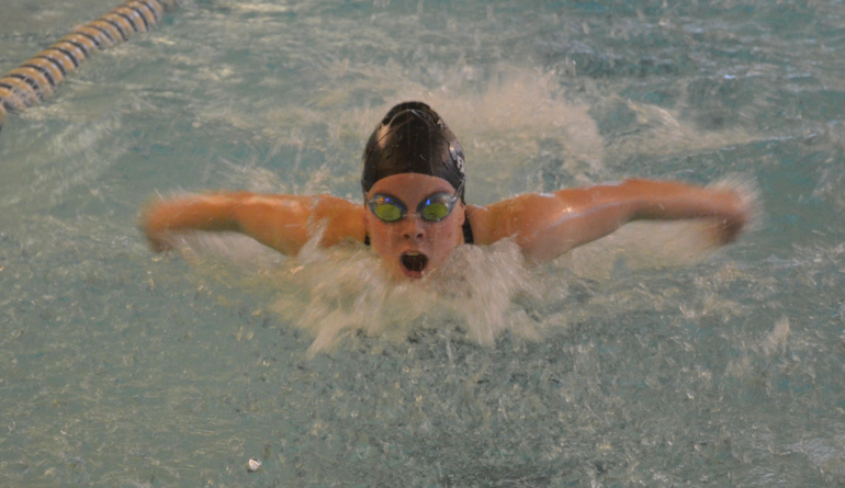 Summit's Caitlin Fagan wins the 100 Butterfly.png