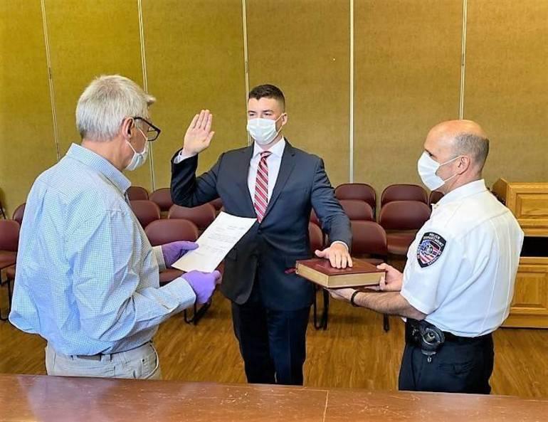 Supervisor Ken Schmitt swears in Devon Sanborn.jpeg