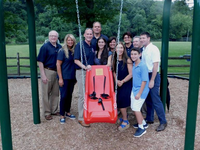 Woodland Park Receives Donation of Adaptive Swing From '50 Red Swings'