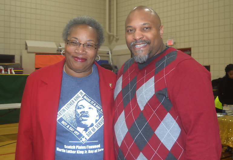 Sylvia Hicks and Pastor Wallace from St. John's Baptist Church in Scotch Plains.png